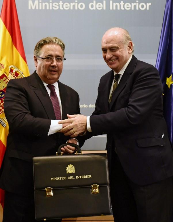 Los exministros de Interior Juan Ignacio Zoido y Jorge Fernández Díaz. - AFP
